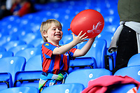 Who needs video games when a balloon can bring so much enjoyment to a childs face, a young Crystal Palace fan before Crystal Palace vs Brighton & Hove Albion, Premier League Football at Selhurst Park on 14th April 2018
