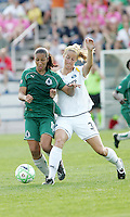 Daniela Alves #10 challenged by Allison Falk...Saint Louis Athletica and LA Sol, played to a 0-0 tie at Robert Hermann Stadium in St Louis, MO. April 25 2009.