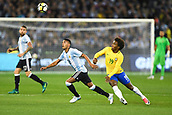 June 9th 2017, Melbourne Cricket Ground, Melbourne, Australia; International Football Friendly; Brazil versus Argentina; Jose Luis Gomez of Argentina and Willian Silva of Brazil chase after the ball