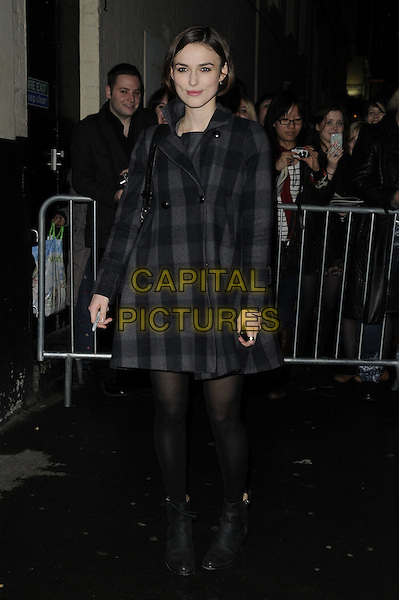 "KEIRA KNIGHTLEY .Departed the evening performance of ""The Children's Hour"", Comedy Theatre, London, England, UK, March 12th 2011.. full length  grey gray black tights checked check coat plaid ankle boots .CAP/CAN.©Can Nguyen/Capital Pictures."