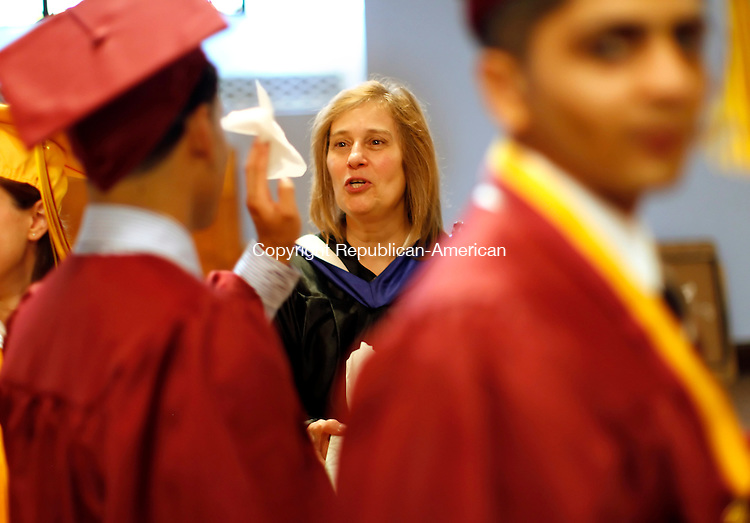 Waterbury, CT-04, June 2010-060410CM12  Joanne Benedict, a teacher at Sacred Heart hands out tissues before the start of Sacred Heart Graduation Friday evening at the Immaculate Conception church in downtown Waterbury. --Christopher Massa Republican-American