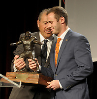 NWA Democrat-Gazette/DAVID GOTTSCHALK Hunter Renfrow (right), wide receiver at Clemson University, receives Monday, December 3, 2018, the 2018 Burlsworth Trophy from Marty Burlsworth, president and chief executive officer of the Brandon Burlsworth Foundation, at the Northwest Arkansas Convention Center in Springdale. The national award is named after Brandon Burlsworth, a former walk-on at the University of Arkansas, and honors the athletic accomplishments of the walk-on student athlete.