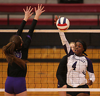 Arkansas Democrat-Gazette/STATON BREIDENTHAL --10/29/19-- Fayetteville's Adrianna Walter hits the ball as Mount St. Mary Academy's Maddie Walters defends Tuesday during their game in the 6A state Volleyball Tournament in Cabot. See more photos at arkansasonline.com/1030volleyball6A/.