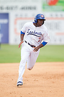 O'Koyea Dickson (7) of the Chattanooga Lookouts hustles towards third base against the Montgomery Biscuits at AT&T Field on July 23, 2014 in Chattanooga, Tennessee.  The Lookouts defeated the Biscuits 6-5. (Brian Westerholt/Four Seam Images)