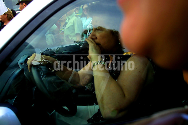 La hija del ex dictador Augusto Pinochet , Lucia Hiriart, llega al hospital donde su padre esta internado luego de sufrir un infarto.*The daughter of former dictator General Augusto Pinochet arrives to the hospital where his father is under intensive care after suffering a heart stroke in Santiago.