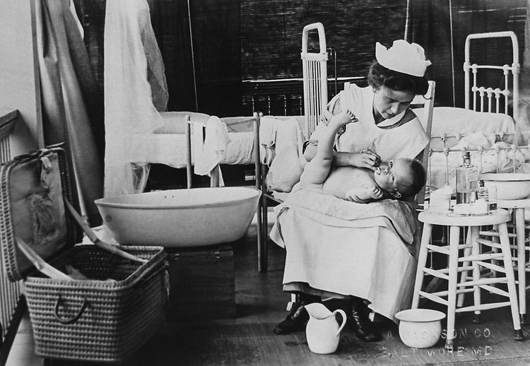 Nurse bathing baby in Baltimore, Maryland on Sep. 16, 1992. (Photo by Library of Congress/CQ Roll Call via Getty Images)
