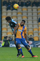 Wycombe Wanderers Sido Jombati wins a header under pressure from Mansfield Town's Adi Yussuf during the Sky Bet League 2 match between Mansfield Town and Wycombe Wanderers at the One Call Stadium, Mansfield, England on 31 October 2015. Photo by Garry Griffiths.