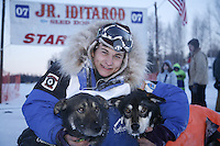 Sunday, February 25th, Willow, Alaska.  Jr. Iditarod musher Rohn Buser poses with his lead dogs at the finish line after winning the 2007 Junior Iditarod