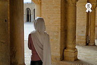 Tunisia, Kairouan, Sidi Oqba Great Mosque, woman wearing veil inside Kairouan Great Mosque (Licence this image exclusively with Getty: http://www.gettyimages.com/detail/sb10065474cy-001 )