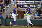 OMAHA, NE - JUNE 26: Antoine Duplantis (20) and Greg Deichmann (7) of Louisiana State University tap helmets after Duplantis scored a solo home run against the University of Florida during the Division I Men's Baseball Championship held at TD Ameritrade Park on June 26, 2017 in Omaha, Nebraska. The University of Florida defeated Louisiana State University 4-3 in game one of the best of three series. (Photo by Justin Tafoya/NCAA Photos via Getty Images)