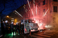 Oslo, Norway 2009: Fireworks explode between police vehicles. Pro-Palestinian protesters clashed with police as they held another demonstration against Israel in the Norwegian capital Oslo. Violent clashes lasted for hours  in the centre of Oslo. Israeli forces began a series of air strikes on the Gaza Strip on the 27th of December in retaliation against Hamas rockets fired into Israel. After eight days of bombardment, leaving over 400 Palestinians and four Israelis dead, Israeli tanks launched a ground invasion on the 4th of January.