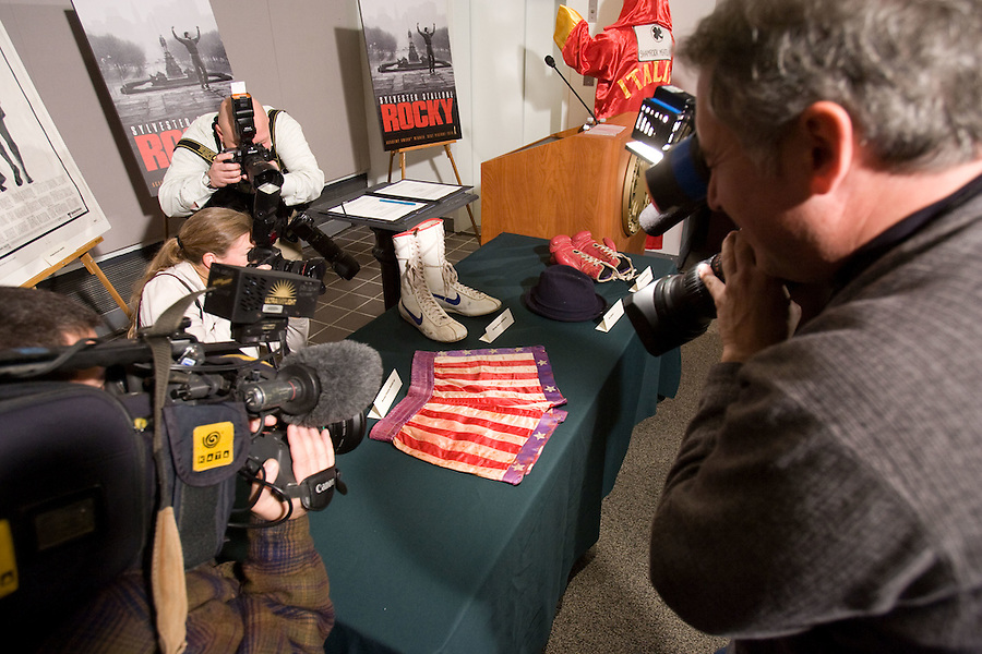 Slug: WK/ Stallone.Date: 12-6-2006.Photographer: Mark Finkenstaedt FTWP.Location:  Air & Space Museum.Caption: Sylvester Stallone visits the Air & Space Museum to conribute items from this Rocky movies that have moved into movie lore to the National Museum of American History .  He gave items from the Rocky movies including boxing shorts, shoes, gloves and his famous robe.  Jennifer Flavin his wife is seated beside him