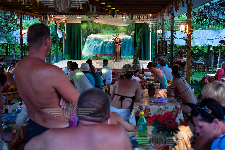 Russian tourists watching a folk show depicting the traditions of the Circassian people. In the villages between Sochi and Djubga there are numerous such places offering Russian tourists an 'authentic' experience of Circassian history and culture.