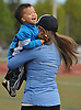 Joseph Chin, 2, of Syosset, enjoys a whirl through the air from his mother, Lisa, before the start of the Long Island Marathon Weekend's Kids Fun Run at Mitchel Athletic Complex on Saturday, Apr. 30, 2016.