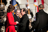 First lady Michelle Obama welcomes President Francois Hollande of France to the White House during an arrival ceremony on the South Lawn of the White House in Washington, District of Columbia, U.S., on Tuesday, Feb. 11, 2014.  United States President Barack Obama and Hollande will meet in the Oval Office for policy meetings, hold a joint press conference and attend a State Dinner later in the evening.<br /> Credit: Pete Marovich / Pool via CNP