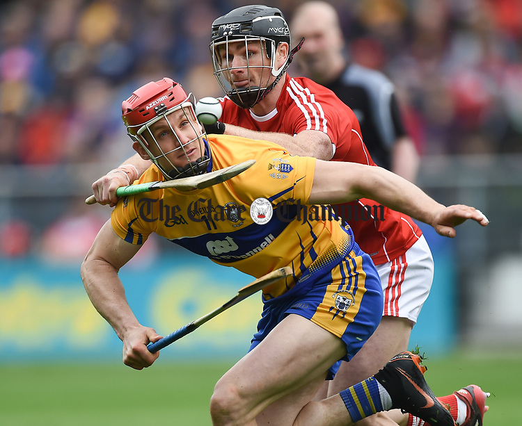 John Conlon of Clare in action against Colm Spillane of Cork during their Munster Senior game at Pairc Ui Chaoimh. Photograph by John Kelly.