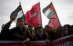 Palestinian supporters of the Democratic Front for the Liberation of Palestine (DFLP) shout slogans and hold flags of the movement during an anti-Israel protest marking the 47th anniversary of the DFLP establishment on February 22, 2016 near a border fence with Israel, east of Rafah, in the southern Gaza Strip. Photo by Abed Rahim Khatib