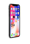 Apple iPhone X, large screen smartphone, product still life with colorful red blue desktop display standing at an angle isolated on white studio background with a clipping path.