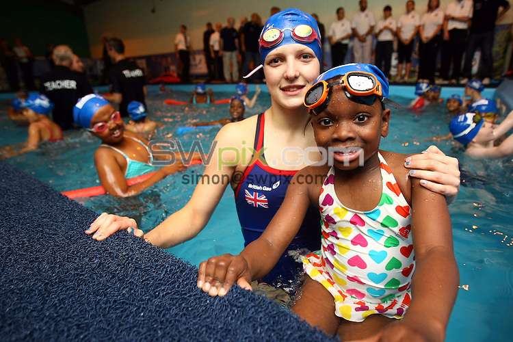 PICTURE BY VAUGHN RIDLEY/SWPIX.COM - Swimming - Pools 4 Schools - King Edward VI Playing Fields, Birmingham, England - 03/11/10...Copyright - Simon Wilkinson - 07811267706...Great Britain's Rebecca Cole and children from Lozells Primary School in Birmingham swim in the British Gas Pools 4 Schools pool at the King Edward VI Playing Fields.