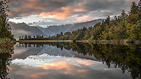 Sunrise at Lake Matheson with reflections of Mt. Cook and Mt. Tasman, Westland National Park, West Coast, World Heritage Area, New Zealand