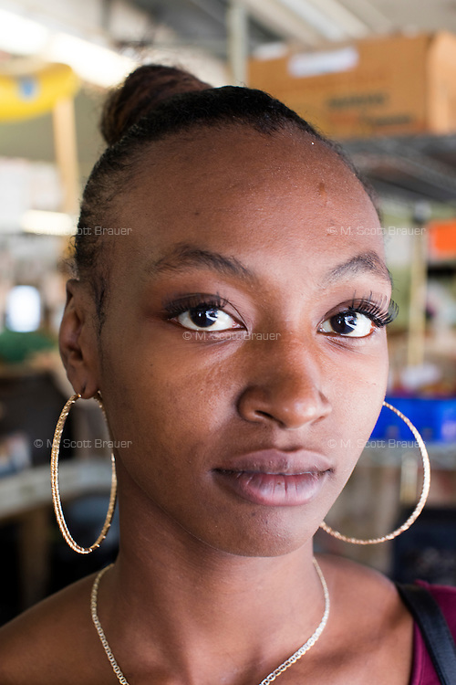 Rashona Ratchford works in a cooperative hydroponic vegetable seller's stand in Cleveland's West Side Market.