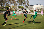Etihad al-Shijaiyah team (Black) and Khadamat Rafah team (green) competi during the final match in Palestine Cup for Southern Governorates championship, at Yarmok staduim, in Gaza city, April 22, 2019. Khadamat Rafah won the championship by penalty shootout. Photo by Mahmoud Ajjour