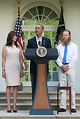 As the parents of United States Army Sergeant Bowe Bergdahl, Jani Bergdahl (left) and Bob Bergdahl (right) look on, U.S. President Barack Obama (center) makes a statement  regarding the release of their son Sgt. Bowe Bergdahl by the Taliban, Saturday May 31, 2014, in the Rose Garden at the White House in Washington, D.C.<br /> Credit: John Harrington / Pool via CNP