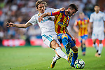 Luka Modric (l) of Real Madrid battles for the ball with Jose Luis Gaya Pena of Valencia CF during their La Liga 2017-18 match between Real Madrid and Valencia CF at the Estadio Santiago Bernabeu on 27 August 2017 in Madrid, Spain. Photo by Diego Gonzalez / Power Sport Images