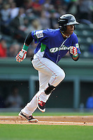 Second baseman Luis Alejandro Basabe (5) of the Greenville Drive runs toward first base in a game against the Asheville Tourists on Sunday, April 10, 2016, at Fluor Field at the West End in Greenville, South Carolina. Greenville won 7-4. (Tom Priddy/Four Seam Images)