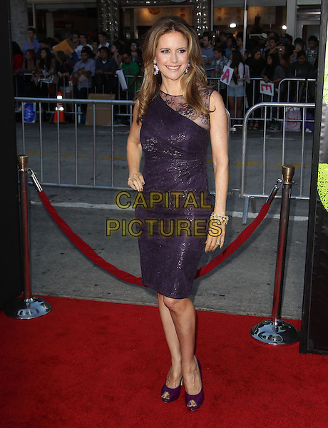 Kelly Preston.The World Premiere of 'Savages' held at The Grauman's Chinese Theatre in Hollywood, California, USA..June 25th, 2012.full length dress lace purple hand on hip.CAP/ADM/KB.©Kevan Brooks/AdMedia/Capital Pictures.