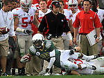 Oregon's LaMichael James reaches for an extra yard in front  Ohio State's bench in the 96th Rose Bowl in Pasadena, Ca January 1, 2010.