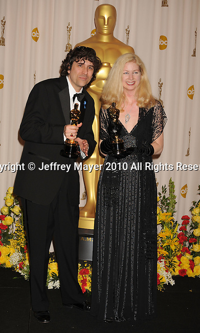 HOLLYWOOD, CA. - March 07: Editors Bob Murawski (L) and wife Chris Innis, winners of Best Film Editing award for 'The Hurt Locker,' pose in the press room at the 82nd Annual Academy Awards held at the Kodak Theatre on March 7, 2010 in Hollywood, California.