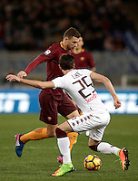 Calcio, Serie A: Roma, stadio Olimpico, 19 febbraio 2017.<br /> Roma&rsquo;s Edin Dzeko in action with Torino's Sasa Lukic during the Italian Serie A football match between As Roma and Torino at Rome's Olympic stadium, on February 19, 2017.<br /> UPDATE IMAGES PRESS/Isabella Bonotto