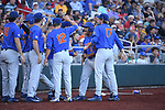 OMAHA, NE - JUNE 26: Nelson Maldonado (27) of the University of Florida celebrates with his teammates after scoring a run against Louisiana State University during the Division I Men's Baseball Championship held at TD Ameritrade Park on June 26, 2017 in Omaha, Nebraska. The University of Florida defeated Louisiana State University 4-3 in game one of the best of three series. (Photo by Jamie Schwaberow/NCAA Photos via Getty Images)
