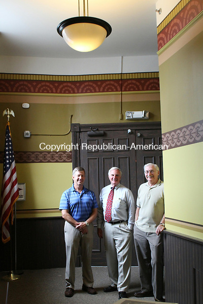 THOMASTON, CT, 21 August 2014-082114LW02 -  From left, stencilist Michael Burr, Chairman of Friends of the Thomaston Opera House Roy Bouffard and painter Karl Weber stand in the newly-renovated hallway to the Opera House on Main Street.<br /> Using a 2005 study by Conrad Schmitt Studios, the non-profit group hopes to return the Opera House to its 1884 condition. Kronenberger and Sons designed the pattern and colors for the hallway based on original stencils and color schemes still visible in the main part of the theater. The hallway project cost close to $10,000, Bouffard said.<br /> Next, the Friends hope to restore the back wall of the opera house, repainting an eagle behind the projection booth that was removed and repainting the walls with original colors and stencil patterns. He hopes to raise funds for the $57,000 project to secure a matching grant through the state. <br /> Anyone who wishes to donate can send a check payable to Friends of the Thomaston Opera House to PO Box 455, Thomaston, CT.<br /> Laraine Weschler Republican-American