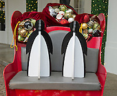 """Two baby penguins at the reigns of a sleigh greet guests at the East Visitor Entrance as part of the 2015 White House Christmas theme """"A Timeless Tradition"""" at the White House in Washington, DC on Wednesday, December 2, 2015.<br /> Credit: Ron Sachs / CNP"""