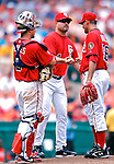 5 August 2007: Washington Nationals Manager Manny Acta (center) relievs pitcher Luis Ayala (right) during a stop in game action against the St. Louis Cardinals at RFK Stadium in Washington, DC. The Nationals defeated the Cardinals 6-3 to sweep their 3-game series...Mandatory Photo Credit: Ed Wolfstein Photo