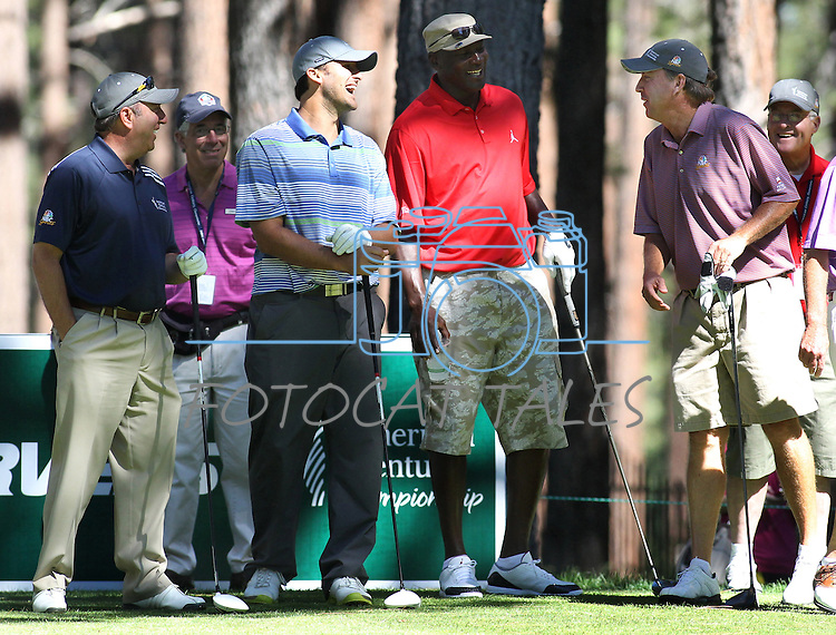 Dallas Cowboys quarterback Tony Romo and former NBA player Michael Jordan talk with Jon Miller, left, and Tom Randolph, right, during a practice round for the 22nd American Century Celebrity Golf Championship at Edgewood Tahoe Golf Course in Stateline, Nev., on Wednesday, July 13, 2011. .Photo by Cathleen Allison