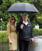 United States President Donald J. Trump and first lady Melania Trump look towards the press pool prior to their Marine One departure from the White House September 2, 2017 in Washington, DC. The President and first lady are traveling to Texas to visit individuals impacted by Hurricane Harvey. <br /> Credit: Olivier Douliery / Pool via CNP /MediaPunch