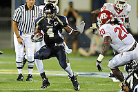 11 September 2010:  FIU wide receiver T.Y. Hilton (4) evades Rutgers cornerback Khaseem Greene (20) in the second quarter as the Rutgers Scarlet Knights defeated the FIU Golden Panthers, 19-14, at FIU Stadium in Miami, Florida.