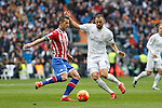 Real Madrid´s Karim Benzema (R) and Sporting de Gijon´s Luis Hernandez during 2015/16 La Liga match between Real Madrid and Sporting de Gijon at Santiago Bernabeu stadium in Madrid, Spain. January 17, 2015. (ALTERPHOTOS/Victor Blanco)