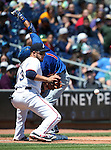 Iowa Cubs&rsquo; Munenori Kawasaki beats the throw to Reno Aces&rsquo; Carlos Rivero at third base in a game at Greater Nevada Field in Reno, Nev., on Tuesday, May 17, 2016. <br />Photo by Cathleen Allison