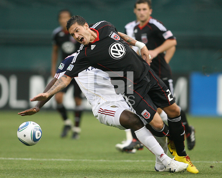 Santino Quaranta #25 of D.C. United is tackled from behind by Jean Alexandre #12 of Real Salt Lake during an MLS match at RFK Stadium, on June 5 2010 in Washington DC. The game ended in a 0-0 tie.