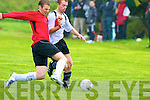 Castlegregory Celtic's Padraig Scully and Asdee Rovers Joesph O'Brien..