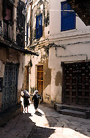 Muslim schoolgirls in a street in the UNESCO World Heritage site of Stone Town in Zanzibar, Tanzania, Africa. July 1997