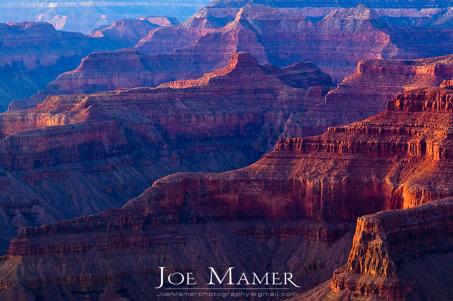 Sunlight on red rock of the Grand Canyon at sunset