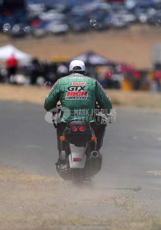 Jul. 26, 2009; Sonoma, CA, USA; NHRA funny car driver John Force during eliminations in the Fram Autolite Nationals at Infineon Raceway. Mandatory Credit: Mark J. Rebilas-