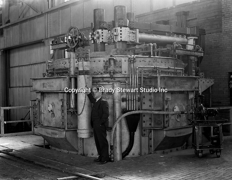 Pittsburgh PA: On location photography for the Swindell Dressler Company. Salesman demonstrating the new Swindell-Dressler Electric Arc Furnace at Swindell's manufacturing plant outside Pittsburgh - 1931