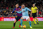 Lionel Andres Messi of FC Barcelona (L) fights for the ball with Stanislav Lobotka of RC Celta de Vigo during the La Liga 2018-19 match between FC Barcelona and RC Celta de Vigo at Camp Nou on 22 December 2018 in Barcelona, Spain. Photo by Vicens Gimenez / Power Sport Images