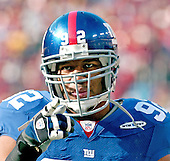 Landover, MD - December 24, 2005 -- New York Giant defensive end Michael Strahan (92) responds to the taunts of the fans prior to the game against the Washington Redskins at FedEx Field in Landover, MD on December 24, 2005.  The Redskins won the game 35 - 20..Credit: Ron Sachs / CNP.(RESTRICTION: NO New York or New Jersey Newspapers or newspapers within a 75 mile radius of New York City)